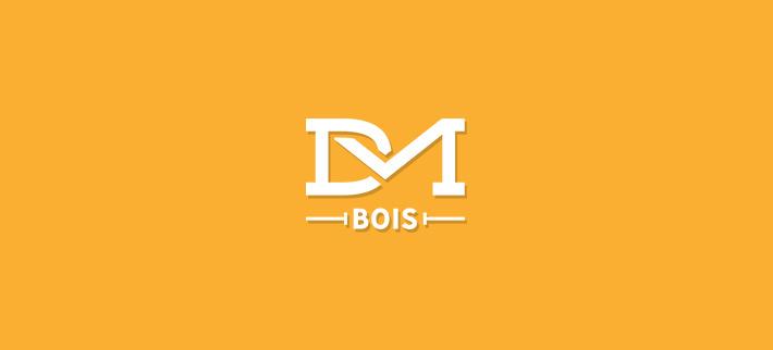 Logo de l'entreprise Dubosson et Martenet. Spécialisée dans la construction, l'agencement et la rénovation, cette entreprise est l'unique fournisseur de chalet bois-vieilli en Suisse.